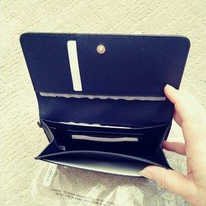 Coach Bags - ❤ Coach Flap Phone Wallet ❤